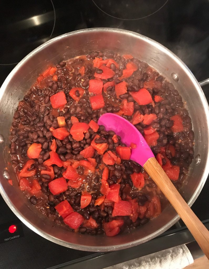 skillet black beans diced tomatoes seasonings on stove